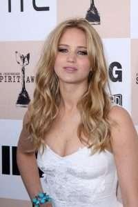 Jennifer Lawrence with glamorous long wavy blonde hair