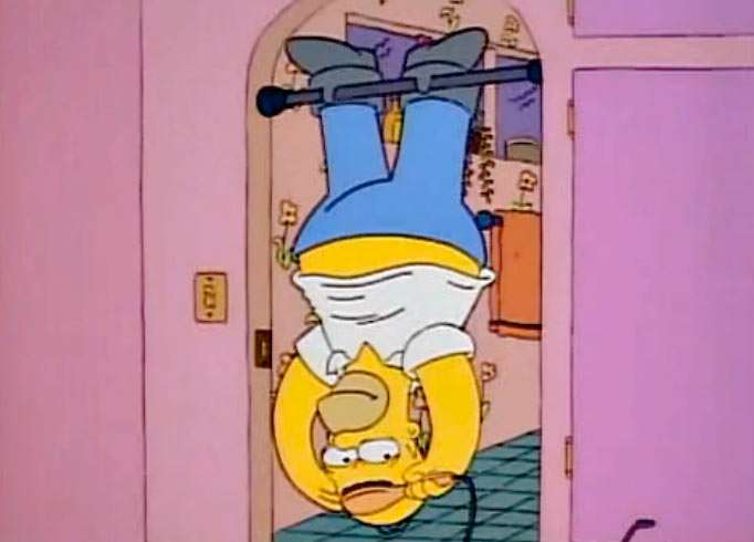 Homer massaging his scalp while hanging upside down