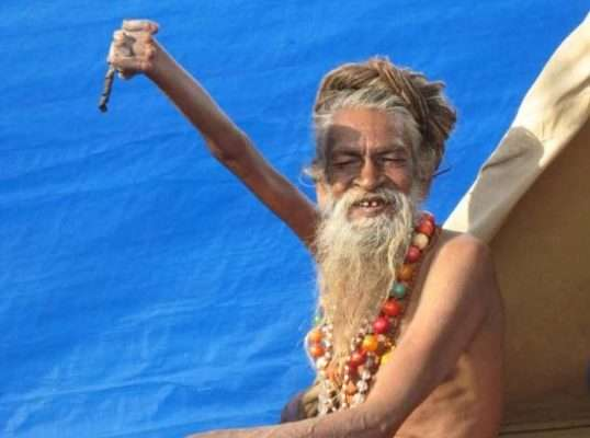 Indian man held hand up for years