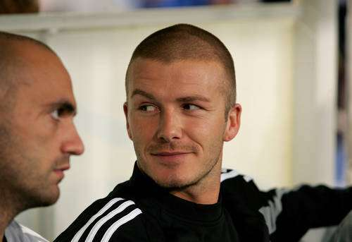 David Beckham with shaven hair skinhead