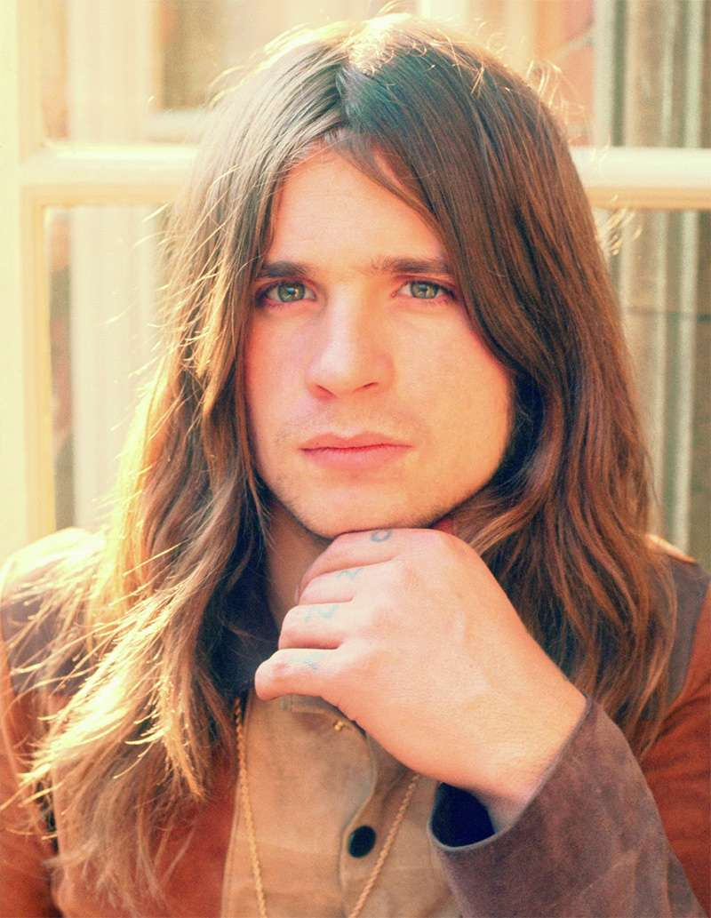 A Young Ozzy Osbourne with Long Brown Hair